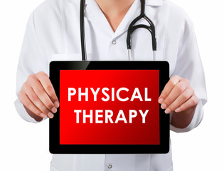 Doctor showing digital tablet screen.Physical Therapy
