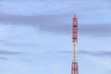 Telecommunication tower red and white antenna radio telephone mobile on sky background