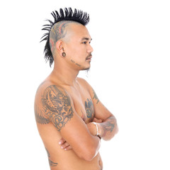 portrait of a mad asian punk guy with mohawk hair style, piercing and tattoo isolated on a white background