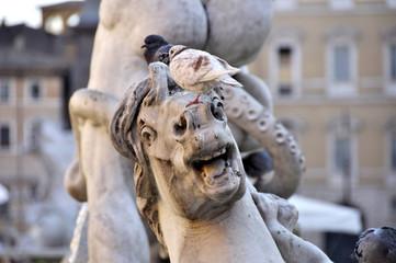 Closeup bird on horse sculpture