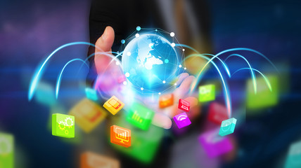 Businessman holding glowing globe with social media icons. New media technology