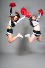 Two Cheerleaders Jumping