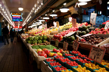 SEATTLE, WASHINGTON, USA - JAN 24th, 2017: Vegetables for sale in the high stalls at the Pike Place Market. This farmer market is a famous sight in downtown.