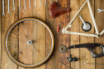 bicycle parts in a table disassembled bike Wall mural