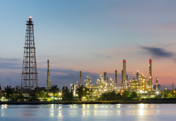 Oil refinery factory with sunrise sky background, industrial landscape background