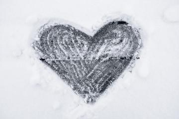 shape of heart on a snow