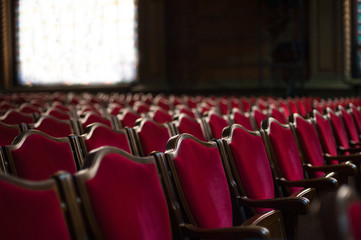 Empty theater hall. Red armchairs