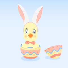A chicken in a hoop with ears like a rabbit sits in the Easter egg