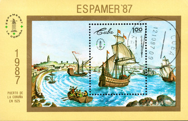 A stamp printed in Cuba shows image wind-driven ships in port of La Coruna in 1525, Espamer '87 Stamp Exhibition, circa 1987