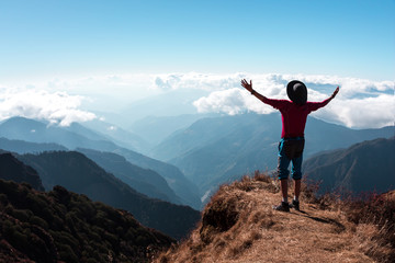 Ecstatic Person in Mountains embracing the World Gesture