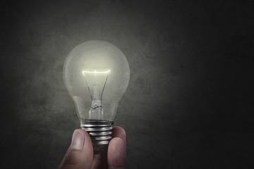 Hand holding bright lamp
