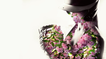 Softball player and flowers. The concept of peace and balance, concentration and a healthy lifestyle.