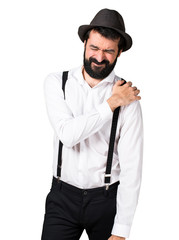Hipster man with beard with shoulder pain
