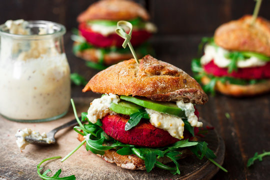 Vegan burgers with beetroot and avocado