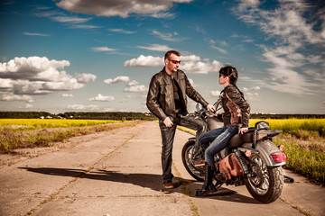 Wall Mural - Bikers couple stands on the road