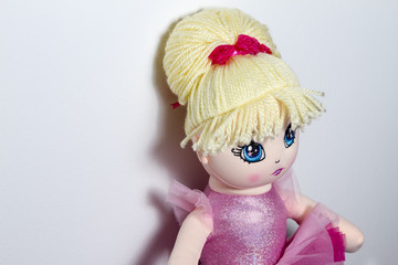 Close up of a ballerina doll on white background.