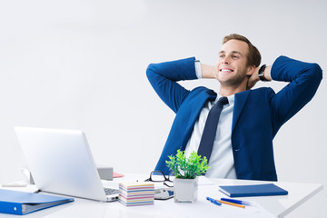 Relaxing or dreaming businessman at office