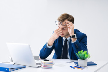 Tired businessman in glasses