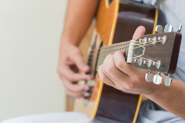 Hand young man playing guitar