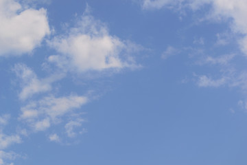 White fluffy clouds in  blue sky and copyspace for backgrounds