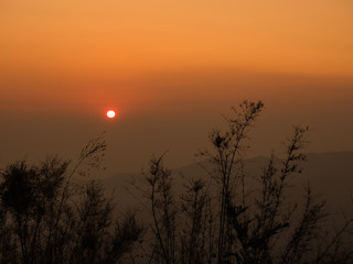 Silhouette Sunrise in Mountain with Mist