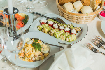 Festively decorated beautiful table full of food ready for guests. Horizontal color photography.