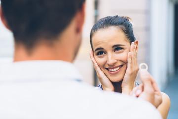 Young man proposing millennial girlfriend young woman