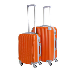 Two suitcases isolated on white background. Polycarbonate suitcases isolated on white. Orange suitcases.