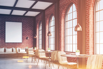 Side view of cafe with chairs, brick, toned