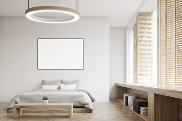 Bedroom with round lamp