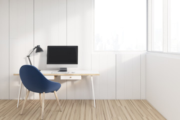 Workplace with a blue chair