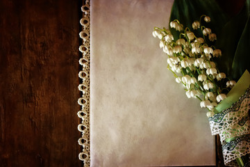 vintage effect on photo bouquet of lilies of the valley and spac