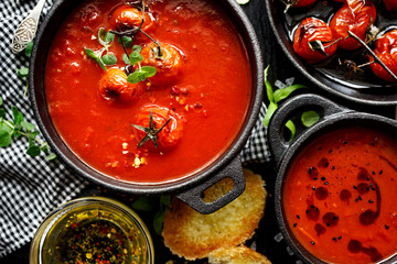 Tomato soup with baked tomatoes, top view