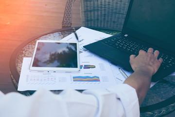 Asian business man using laptop for online shopping.Vintage tone,Retro filter effect,Soft focus,Low light.(selective focus)