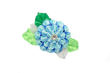 Wall Mural - Kanzashi.Beautiful blue artificial flower with brocade, isolated