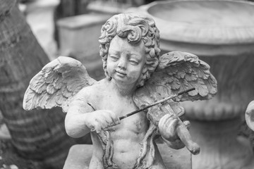 cupid statue, black and white