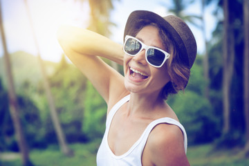 young beautiful hipster woman on tropical ,hat,  sunglasses, stylish, summer vacation in thailand, happy, fun, enjoying, ray of sunshine, sunny