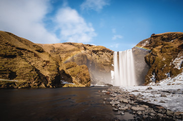 Landscaped, Skogafoss waterfall with rainbow in beautiful day at Iceland