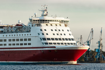Red cruise liner's bow. Passenger ferry underway close up