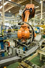 Robot arms handle tool keep automotive part to spot machine