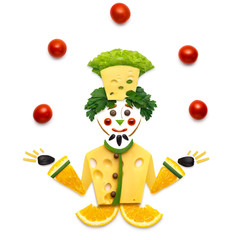 Veggie chef / Creative food concept of a funny cartoon chef made of vegetables on white background.