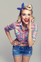 young smiling woman, dressed in pin-up style