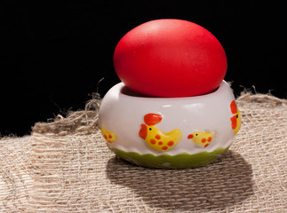 Painted egg on stand