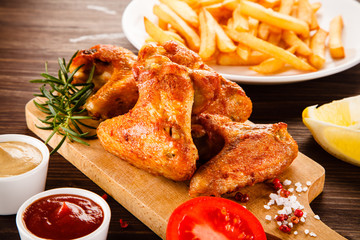 Roast chicken wings with french fries