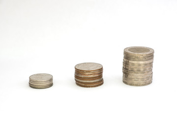 Stack coins growing or saving on white background
