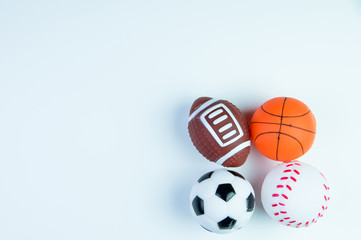 Football toy, Baseball toy, Basketball toy and Rugby toy isolated on white background with copy space.Concept winner of the sport.