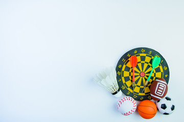 Shuttlecock, Football toy, Darts with crotch, Baseball toy, Basketball toy and Rugby toy isolated on white background with copy space.Concept winner of the sport.