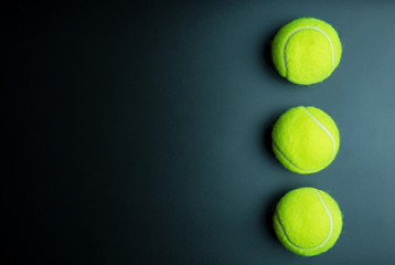 Tennis ball isolated on black background with copy space.