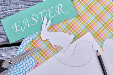 Patterned paper and scissors. Turquoise Easter card. Ideas for Easter school project.