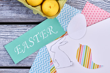 Patterned paper and Easter card. White egg cutout. Easy Easter decoration ideas.